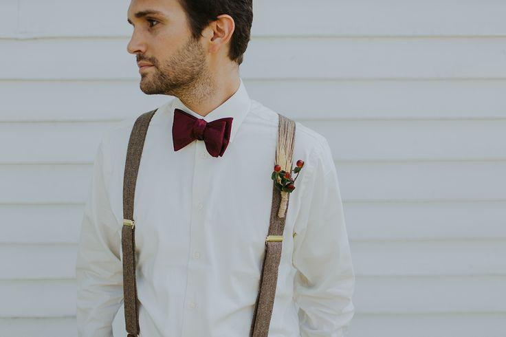 groomsmen in suspenders and maroon bow tie