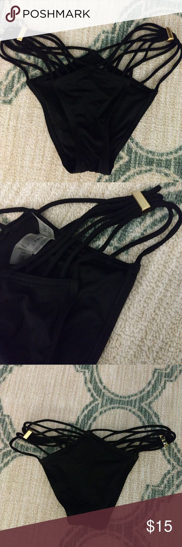 NWOT Victoria's Secret bathing suit bottoms Black strappy bathing suit bottoms with adjustable gold embellishments. They move to allow more strap to the back or front. Very revealing bottoms. Cheeky cut. Victoria's Secret Swim Bikinis