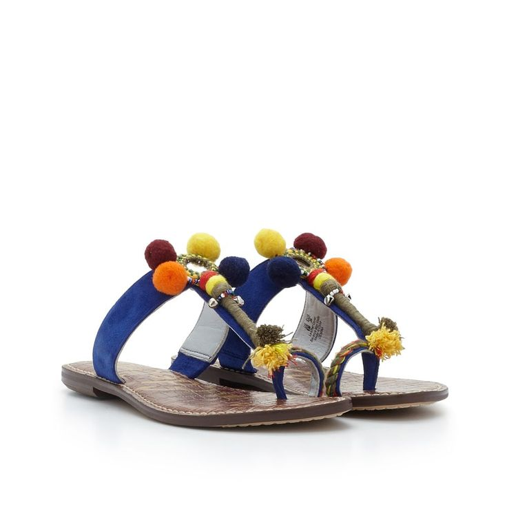 A boho toe ring sandal we love: the embellished Gemina sandal is a versatile must-have. Add ethnic flair to every off-duty outfit with the Gemina's pompoms, mirrored discs and beading. Features slight heel, signature croco sock and blue kid suede upper.Material: Suede