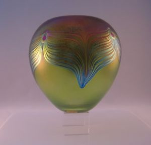 """Beautifully crafted Robert Held Signature Collection Art Nouveau Peacock Rosebowl Vase with Aurora Borealis colors and Light Green.    Made with traditional """"feathering"""" glass blowing techniques, this wonderful piece is hand shaped and the design applied with colored glass then brought to a golden luster just before finishing.   Measures approx. 6.5"""" height + 5.5"""" width"""