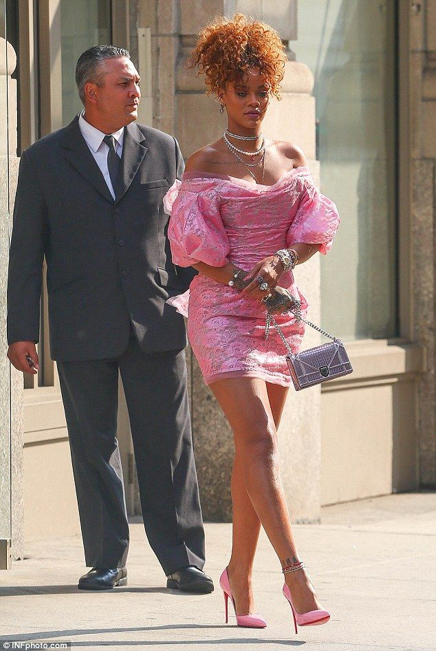 Retro: The chart-topping star stepped out in a bubblegum pink dress as she attended the un...