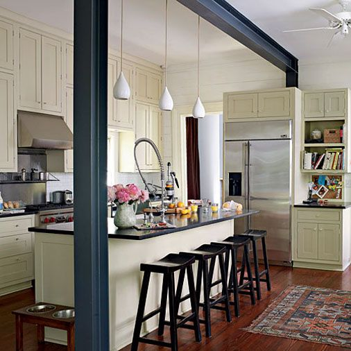 Island for galley kitchen. LOVE the moulding between kitchen and living room.