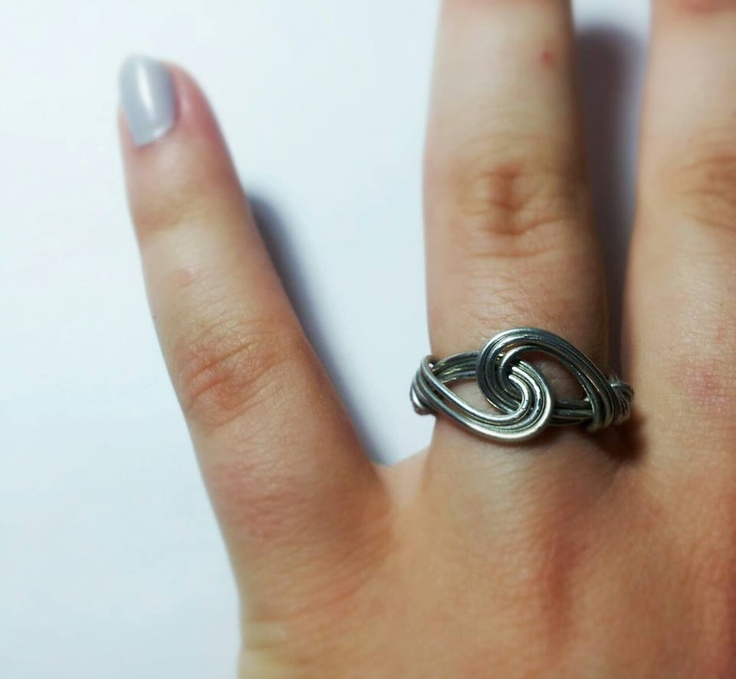 A simple but original ring realized with silver wires that create a beautiful HUG. For info contact me :)