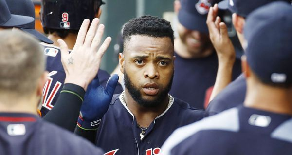 Cleveland Indians' Carlos Santana high-fives teammates in the dugout after scoring on a triple by Austin Jackson during the second inning against the Baltimore Orioles in Baltimore, Thursday, June 22, 2017. (AP Photo/Patrick Semansky) Indians won 6-3