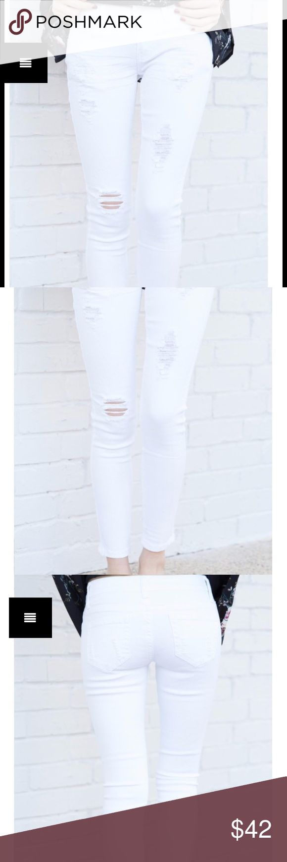 White ripped skinny jeans New. Run small. Size 5 but really like a 6/7- see photos for size information. Distressed skinny. Pants Skinny