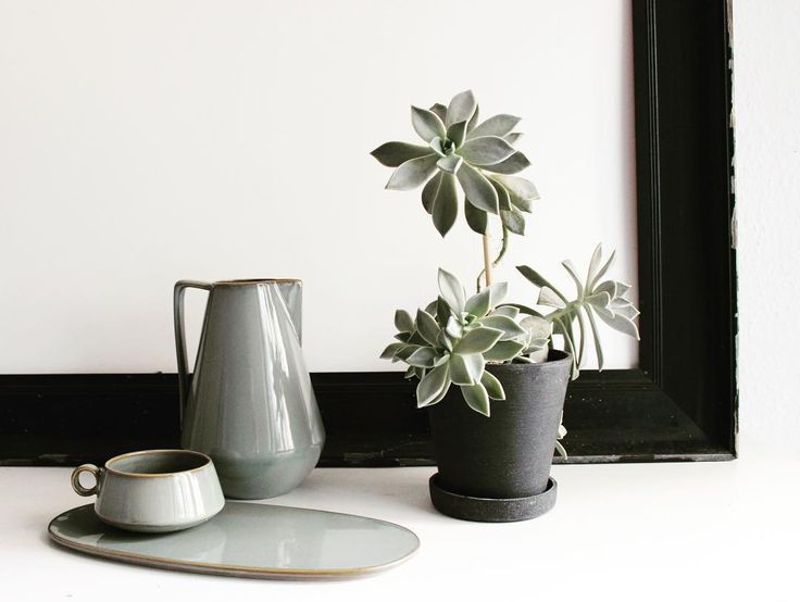 ferm LIVING Neu stoneware series with a reactive grey glaze: http://www.fermliving.com/webshop/shop/kitchen/tableware.aspx