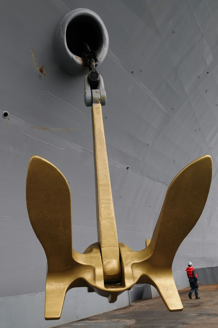 The golden anchor is from the USS Enterprise (CVN-65) the world's first nuclear aircraft carrier that was retired from service in 2012. The Enterprise will be officially decommisioned in 2016. One of her (Enterprise) anchor's is still serving the fleet and is now aboard the aircraft carrier USS Abraham Lincoln (CVN-72) pictured above, when after one of Lincoln's 60,000lb anchors was determined to be unfit for continued service. It was removed, painted gold transported and hoisted aboard the…