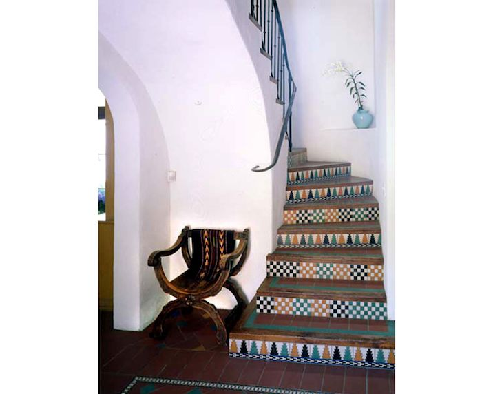 Stair risers in contrasting and complimentary patterns- tiled and painted
