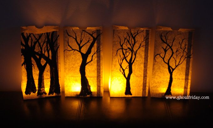 How to make homemade Halloween lanterns with paper bags, black paint, paint brushes, and candles