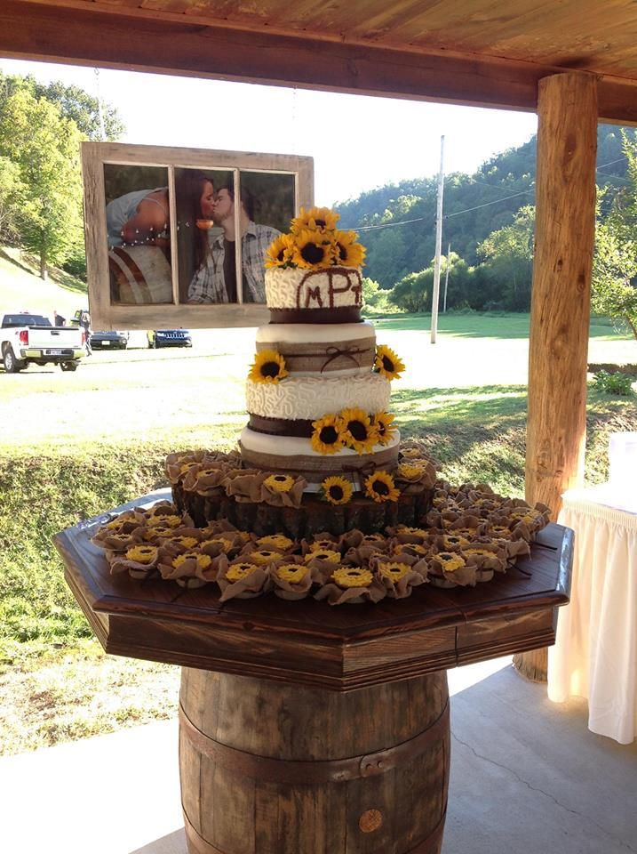 Sunflower wedding cake with cupcakes