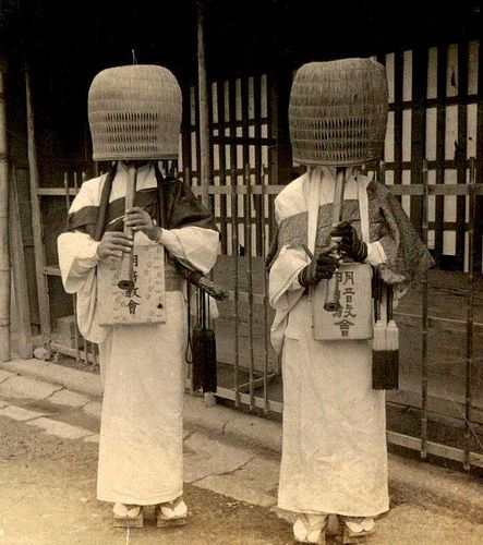 "From the beginning of the 13th century until the Meiji Restoration, an interesting order of Zen Buddhist pilgrim monks roamed in Japan: komusō 「虚無僧」, the ""emptiness monks"". Komusō represented the Fuke Zen Buddhist School, a branch of Buddhism originating from China. Their unusual and distinctive feature, the straw basket worn on the head, symbolized the ""absence of ego""."