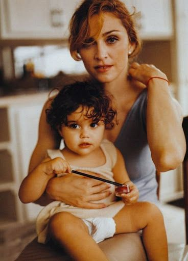 Madonna and baby Lourdes - sorry, I don't know the image credit!