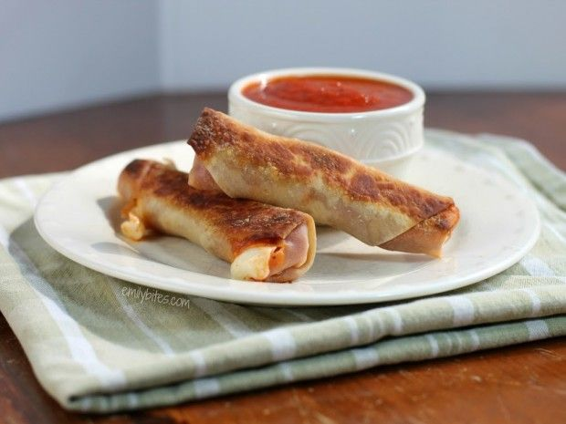These Baked Pizza Logs are one of my most popular recipes! All the pizza flavor you crave for just 97 calories or 2 Weight Watchers SmartPoints each! Perfect as an appetizer or snack. www.emilybites.com
