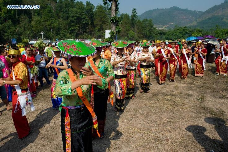 People dance in Feihong Village of Mangshi City, Dai-Jingpo Autonomous Prefecture of Dehong, Yunnan Province, April 11, 2015. Dai people in Mangshi City held celebration for the coming Water-Splashing Festival on Saturday. http://www.chinatraveltourismnews.com/2015/04/celebration-for-water-splashing-festival.html