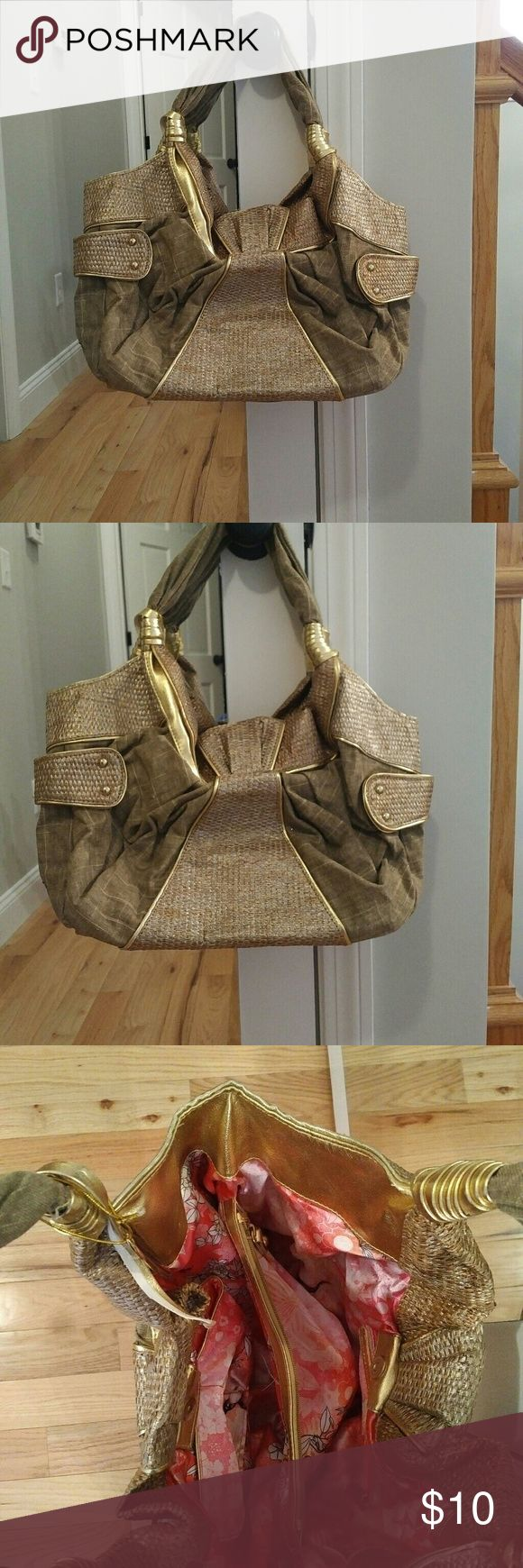 A beige and gold shoulder bag This bag is so pretty. It has a great amount of space and is very light weight. There is a small problem with one of the gold wraps around the handles but it can easily be fixed. Chinese Laundry Bags Shoulder Bags