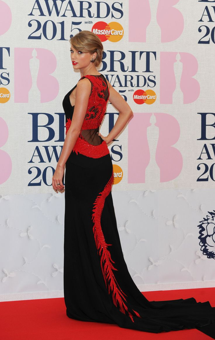 Taylor Swift looked absolutely stunning in a #RobertoCavalliAtelier gown made of black silk cady with a decollete on the back in silk tulle to the BRIT Awards 2015 tonight in London! #CavalliCelebrities