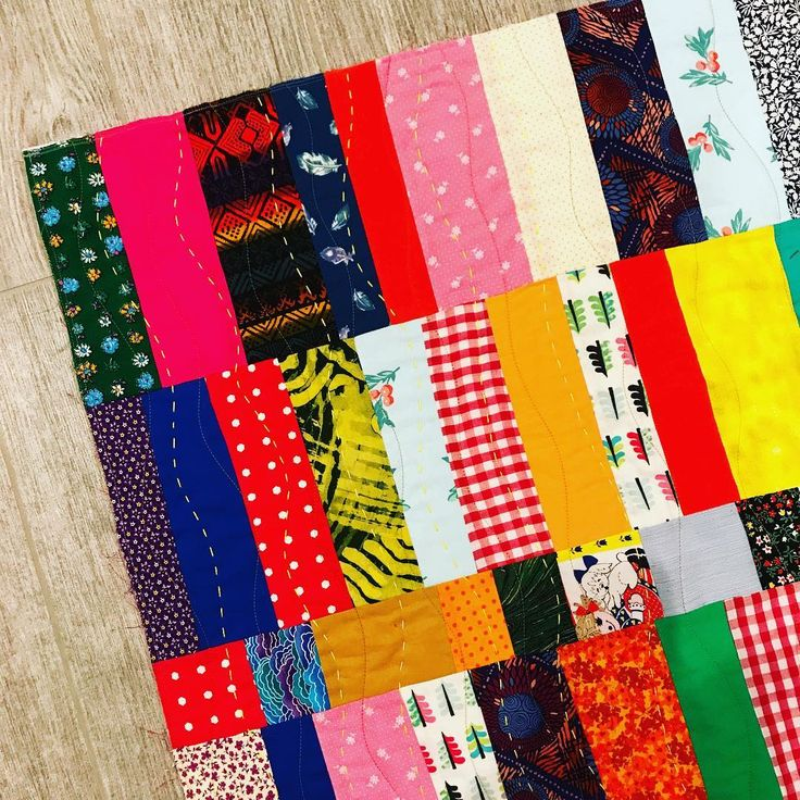 adding hand quilting to a improv strip quilt today...