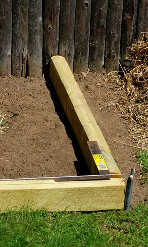 Landscape timber edging installation is simple and looks spiffy. Using photos, I relate how to install it to build an attractive edging with minimal effort.: Set the Corner You've Formed Into Place