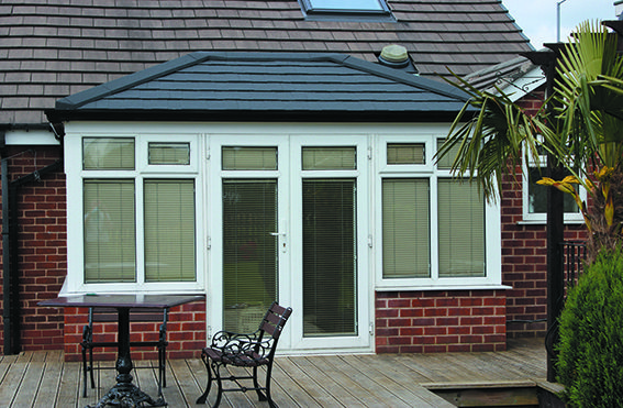 A double-hipped Edwardian roof finished with Metrotile Charcoal tiles.