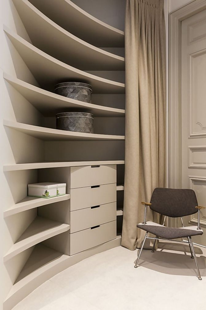 Apartment Saint Germain des Prés, Paris by Gérard Faivre | curved shelving | wardrobe concept