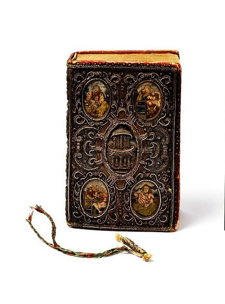 Book cover and book mark, London, ca 1634. Satin covered board, embroidered with silver, silver-gilt-thread, purl and coil, and coloured silks, and plaited threads.