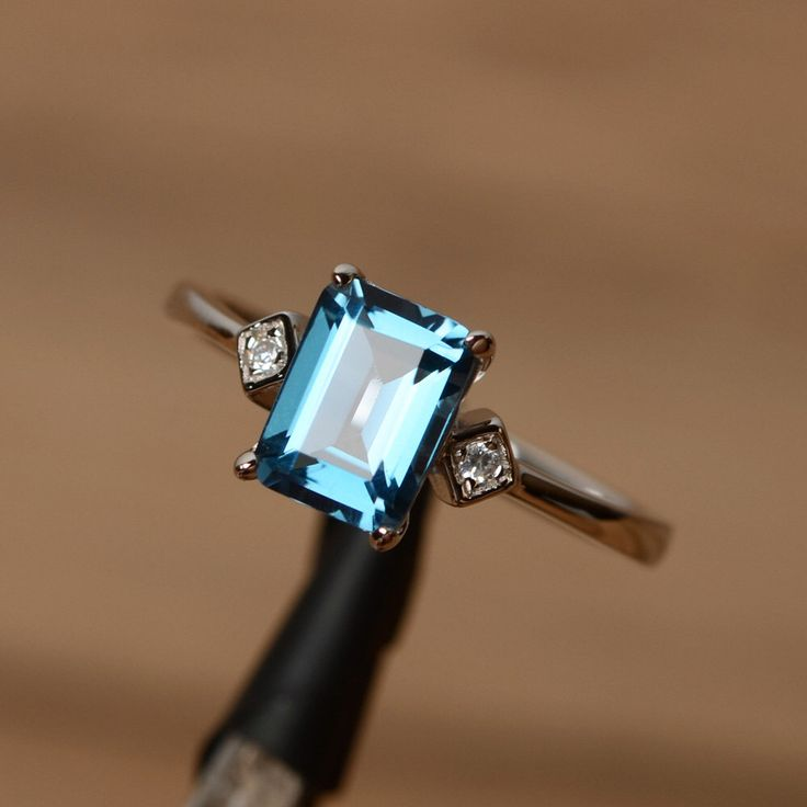 London blue topaz ring emerald cut ring gemstone engagement ring promise ring for her by godjewelry on Etsy https://www.etsy.com/listing/238217563/london-blue-topaz-ring-emerald-cut-ring
