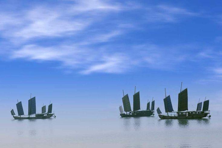What a stunner! Fishing boats sailing in Taihu Lake, Wuxi, China.