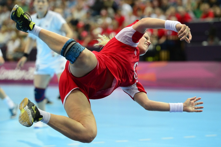 Norway's pivot Heidi Loke jumps as she shoots during the women's preliminaries Group A handball match Norway vs South Korea for the London 2012 Olympics Games on August 1, 2012 at the Copper Box hall in London.
