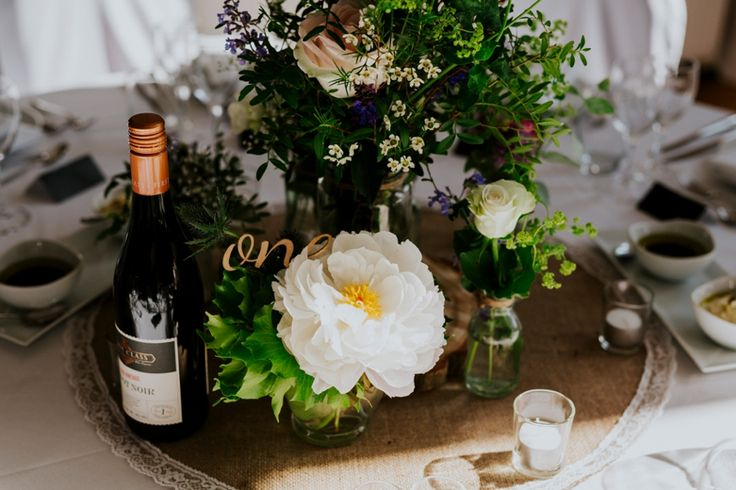 Beautifully floral table centres in a mixture of glassware and at different heights. Photo by Benjamin Stuart Photography #weddingphotography #tablecentre #flowers #weddingflowers #weddingdecor #receptiondecor #dinnerdecor