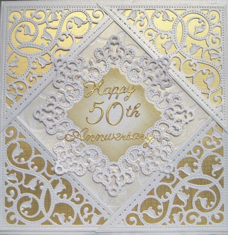 A 50th Anniversary card made using Spellbinders dies. The corner die is a gold die and debosses as well as embosses giving a very pleasing result.