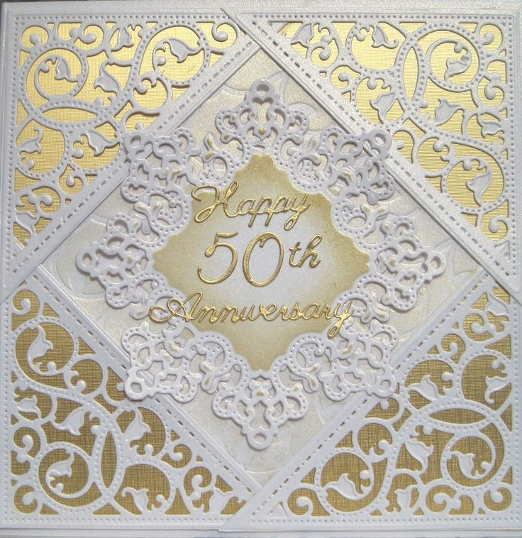A 50th Anniversary card made using Spellbinders dies. The corner die is a gold die and debosses as well as embosses giving a very pleasing result.