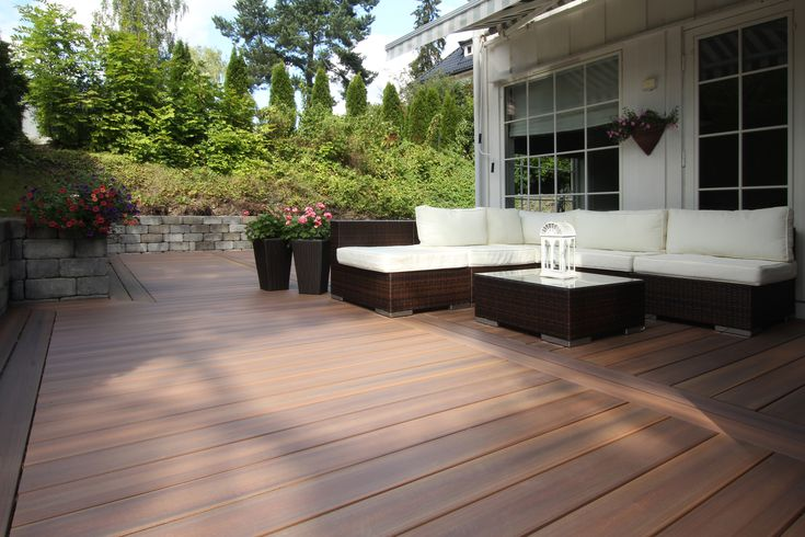 A Backyard Patio Uses Fiberon Composite Decking In A