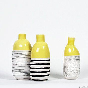 C'est l'Atelier des garçons qui fabrique ces magnifiques bouteilles... teintées de jaune!