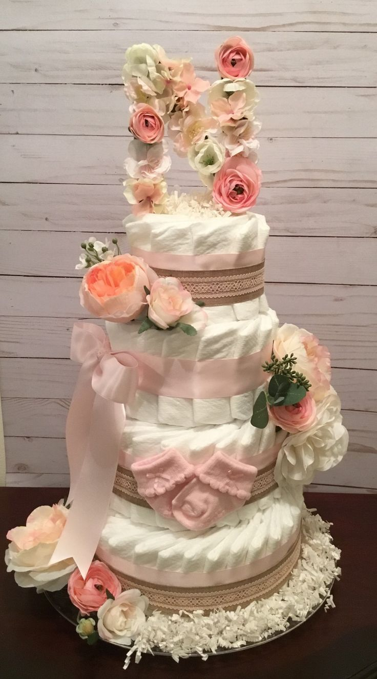 Floral diaper cake with a floral initial letter. Floral baby shower centerpiece