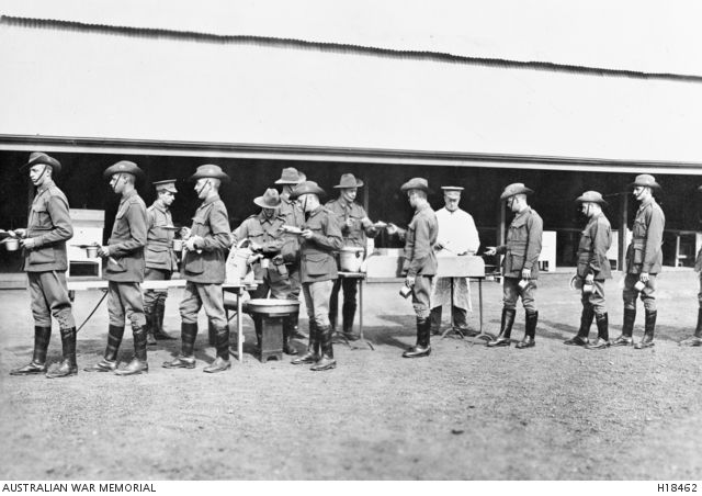 Mitcham, South Australia. Soldiers going through an open meal line at Mitcham Army Camp.