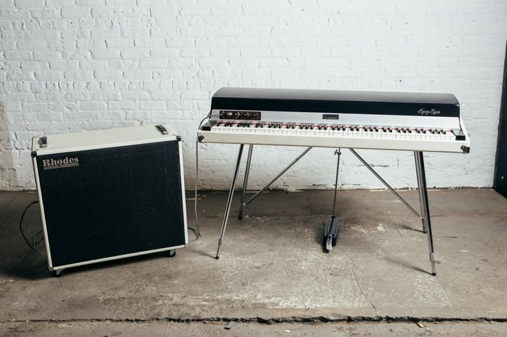"""Up for sale is thisCustomized Rhodes Mark I Stage 88, restored byThe Chicago Electric Piano Company. This piano is upgraded with all new ivory tolex, hardware, premium white and ebony key caps, wooden cheek blocks, and our custom """"Stereophonic Satellite"""" speaker cabinet. The piano is from 1..."""