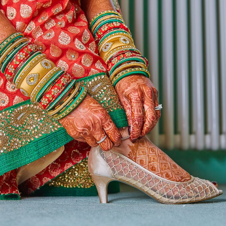 This Image Captured By Active Image, We're Always Drawn To Something New, #Shoes #Ring #AsianBridalOutfit #Bangles #Mehndi Take A Look At Some Amazing Moments Captured By Active Image In Our Latest Issue. Download your FREE copy from the Apple & Google App Stores.#MayaMagazine #AsianWeddingIdeas #Photography #AsianWeddingPhotography #AsianWeddings #Capturing #CreativePhotography #Bride #AsianBride #Emotion #WeddingAlbum