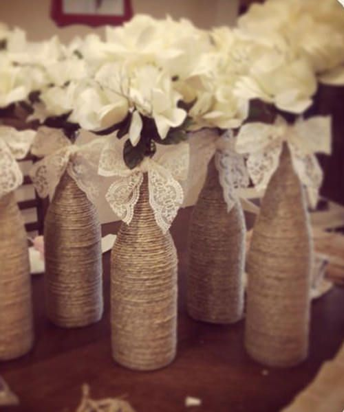 Gorgeous rustic DIY wine bottle wedding centerpiece