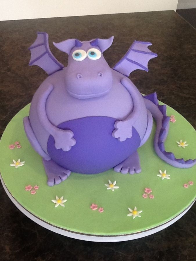 Fondant covered dragon cake, head made from rice krispies, body made using wilton ball tin.