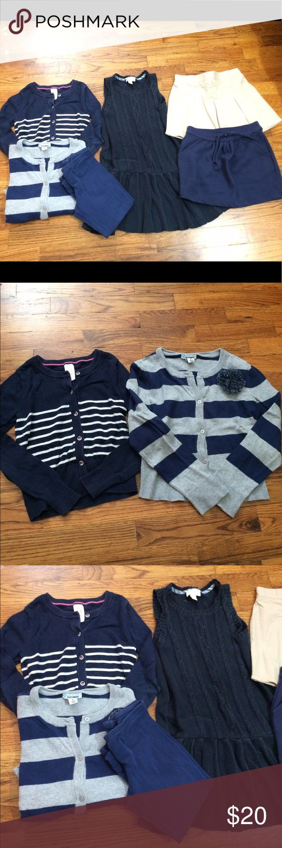 Girls School Uniform Bundle Girls navy and khaki school uniform bundle. All sized 6-6x. Gymboree navy pull on skirt, khaki Pleated Skort by Tough Skins, Knit long jumper from Children's Place, two sweaters- Old Navy and Cat & Jack, navy legging from old navy. All in great shape with no stains or holes. No missing buttons. Just outgrown! Gymboree Matching Sets