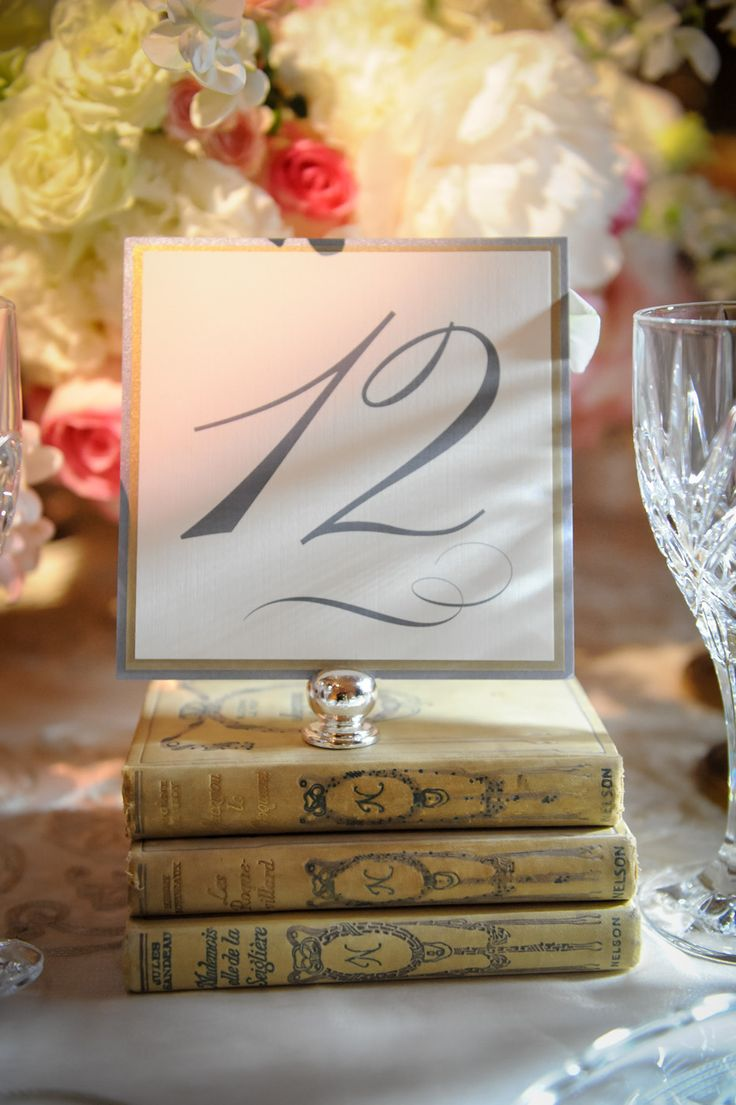 Incorporate vintage books into the table decor for a romantic touch || Photography: La Vie Image