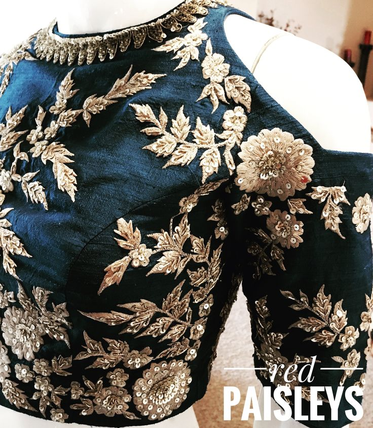 Blue gold Sabyasachi lehenga with cold shoulder top. For more details info@redpaisleys.com or 469.248.7733