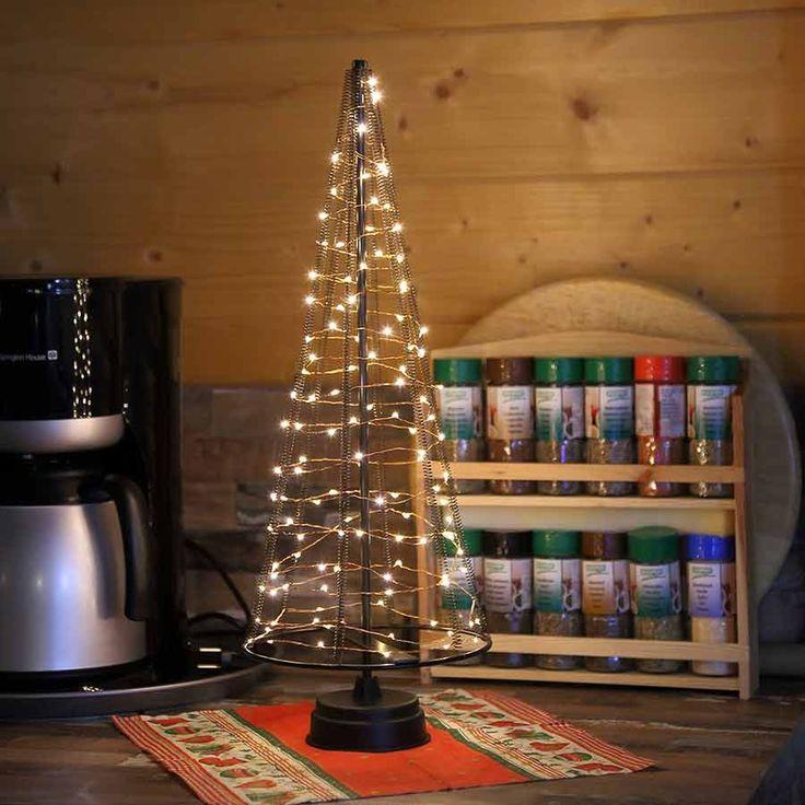 Tischweihnachtsbaum als festliche dekoration zu for Dekoration weihnachtsbaum