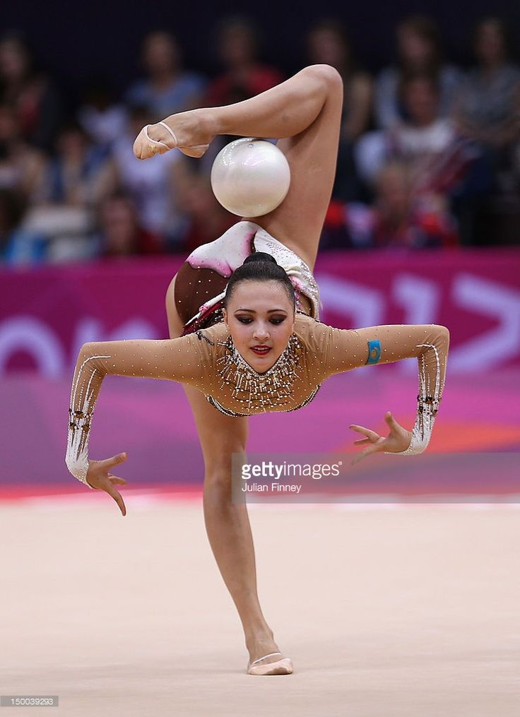 Anna Alyabyeva of Kazakhstan performs with the ball during the Rhythmic Gymnastics qualification on Day 13 of the London 2012 Olympics Games at Wembley Arena on August 9, 2012 in London, England.