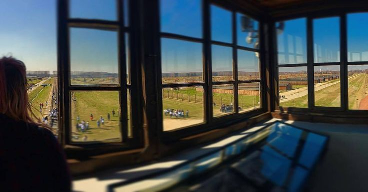 --- Photo by @jesskaysouth --- Auschwitz II-Birkenau. The view from the top of the main watch tower of the camp. The selection ramp as well as some wooden barracks of the men's quarantine camp are visible.