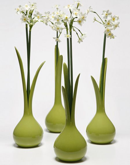 Onion Vase. Stretching the limits between natural and artificial objects in order to raise the question where does the vase end and the flower start. More info here: http://www.iriszohar.com/onionvase.htm and here: http://www.toxel.com/inspiration/2009/05/02/modern-vases-and-creative-vase-designs/