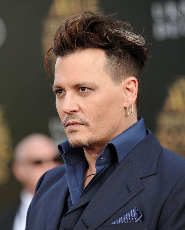 Johnny Depp debuts hair-raising new 'do on the red carpet