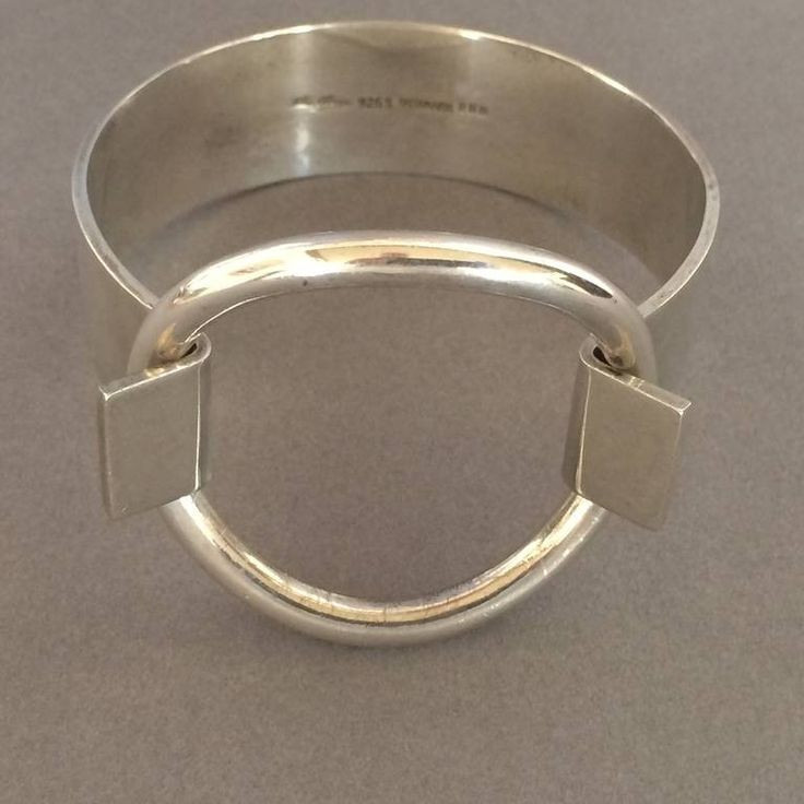 Hans Hansen Sterling Silver Ring Bracelet by Bent Gabrielsen   From a unique collection of vintage cuff bracelets at https://www.1stdibs.com/jewelry/bracelets/cuff-bracelets/