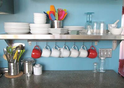 this look is awesome!!! My kitchen doesn't allow for it, but I can hang mugs under the cabinet, love that idea