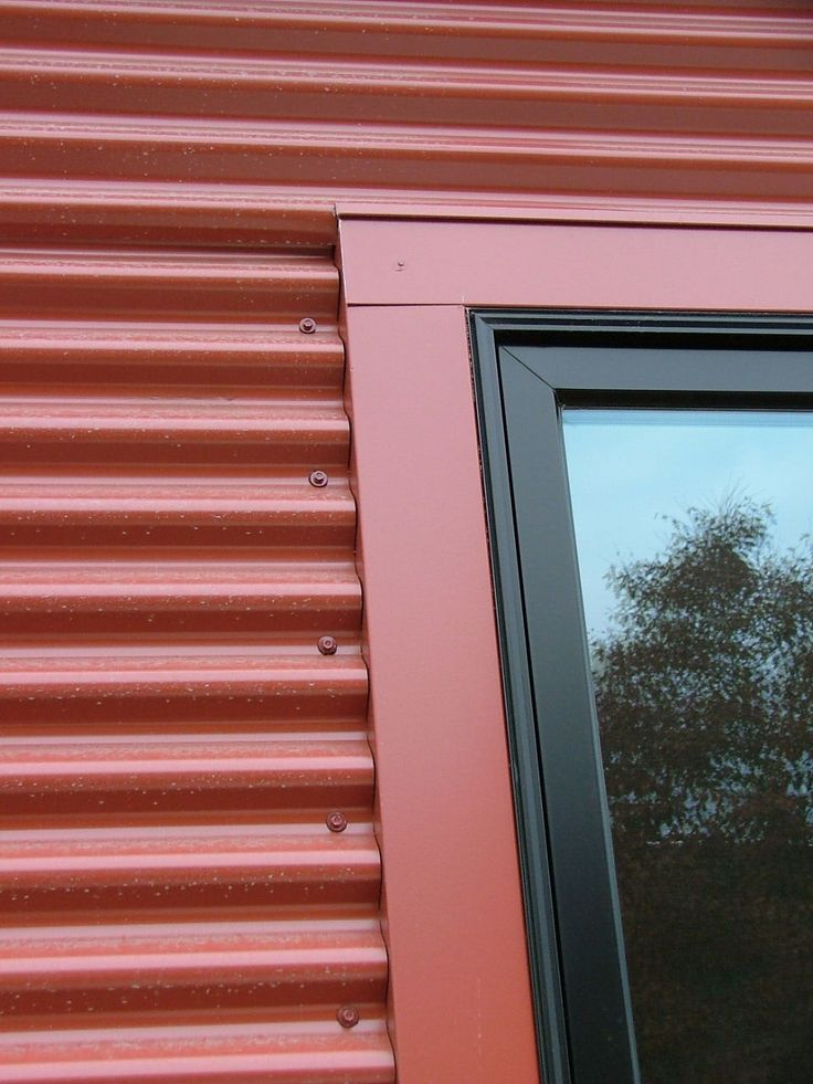 Detail with window frame corrugated steel siding by